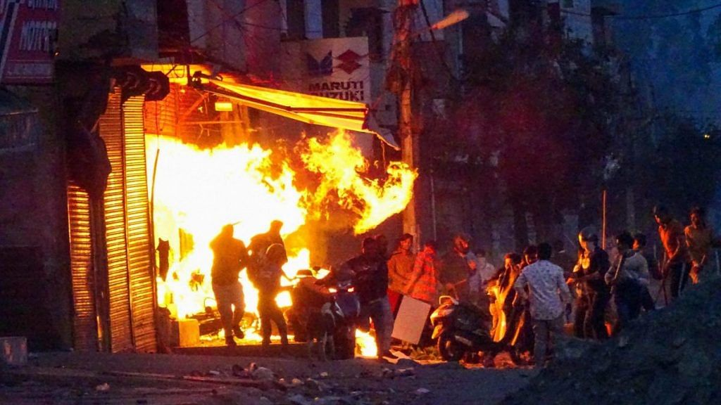 New Delhi: Rioters set ablaze a shop during clashes between those against and those supporting the Citizenship (Amendment) Act in at Gokalpuri in north east Delhi, Tuesday, Feb. 25, 2020 | PTI