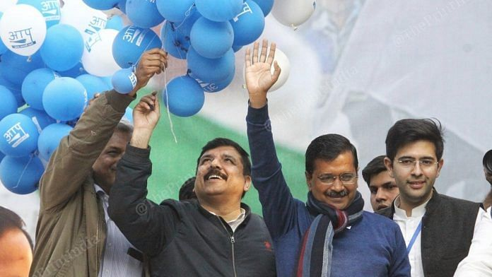 AAP chief Arvind Kejriwal greets people at the party headquarters after winning the Delhi elections   Photo: Praveen Jain   ThePrint