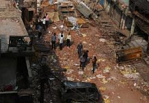People try to salvage what they can from the destroyed property in Shiv Vihar | Photo: Manisha Mondal | ThePrint