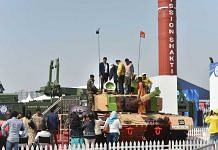 Visitors near the third generation main battle tank Arjun at the 11th edition of DefExpo, in Lucknow Wednesday