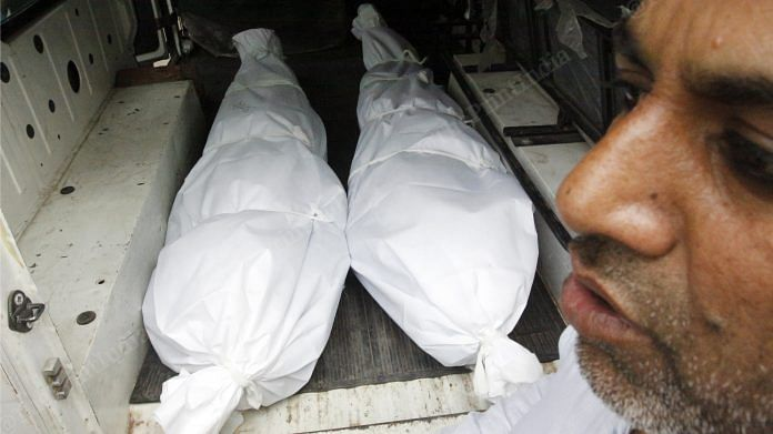 Bodies of Amir and Hashim, kept in a van after the postmortem was conducted at GTB Hospital Saturday. A relative makes arrangements to take the bodies back home | Photo: Praveen Jain | ThePrint