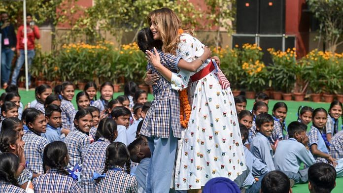 US First Lady Melania Trump hugs a school girl as she attends 'Happiness Class', during her visit to a government school in New Delhi