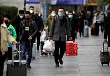 People in masks outside the Shanghai railway station