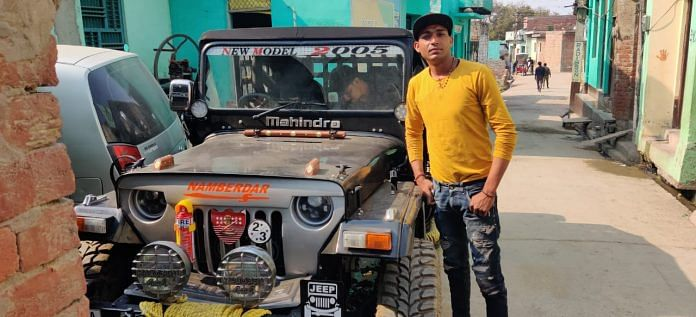 Pushpendar (26) with his newly bought SUV in Rohi Village   Photo: Sajid Ali   ThePrint
