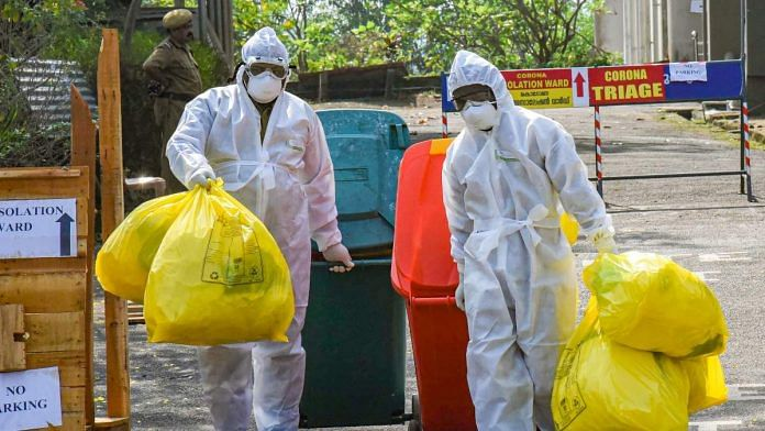 Medical staff outside the special isolation ward set up for coronavirus treatment at Kochi Medical College | PTI