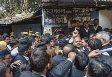 Sanjeev Lodhi (R with raised finger), joint secretary of the Lucknow bar association, along with other lawyers stage a protest after a crude-bomb exploded in the premises of a court, in Lucknow, Thursday. | PTI