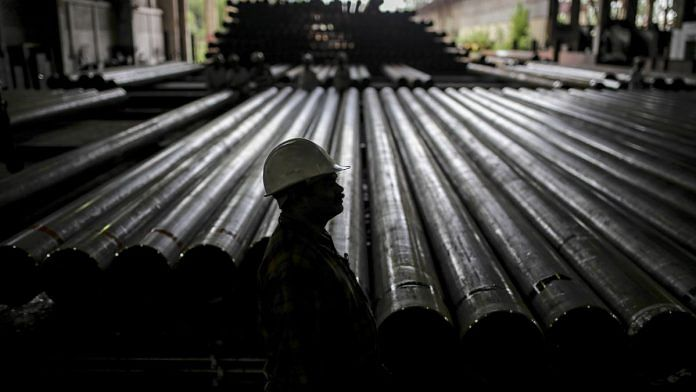 A worker stands in front of steel tubes at the Steel Authority of India Ltd in Rourkela, Odisha   Dhiraj Singh   Bloomberg File photo