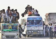 Migrant workers move in packed buses | Photo: Praveen Jain | ThePrint