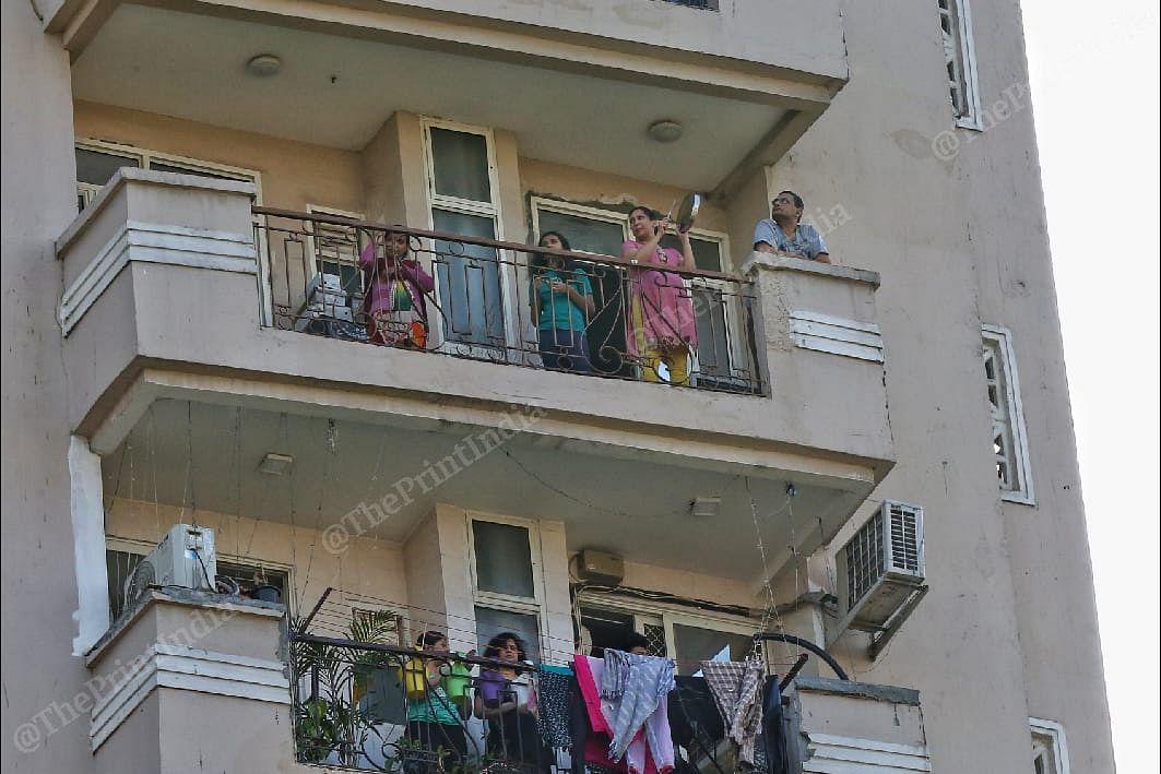 People clap standing at their balconies | Photo: Suraj Singh Bisht | ThePrint