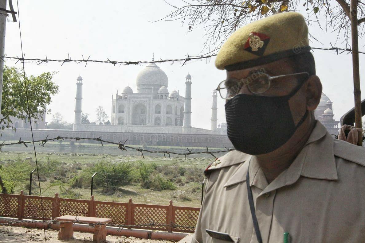 A police officer wearing mask stand outside Taj Mahal premises in Agra | Photo: Praveen Jain | ThePrint