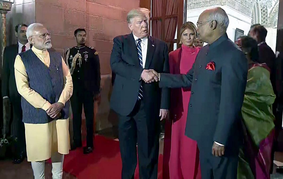 US President Donald Trump shakes hand with President Ram Nath Kovind at the Rashtrapati Bhavan | Photo: ANI