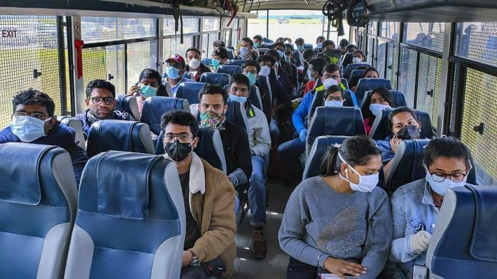 Evacuees airlifted from Rome, Italy on their arrival at IGI airport, before being sent to a quarantine facility in New Delhi on 22 March | Photo: PTI