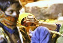 Three pregnant women sitting during the night waiting for conveyance   Photo: Praveen Jain   ThePrint