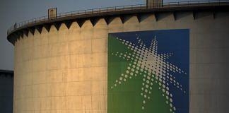A logo sits on display outside an oil storage tank in the Juaymah tank farm at Saudi Aramco's Ras Tanura oil refinery and terminal at Ras Tanura, Saudi Arabia