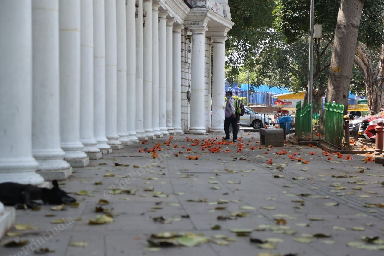 A man wearing mask walks in Connaught Place | Photo: Manisha Mondal | ThePrint