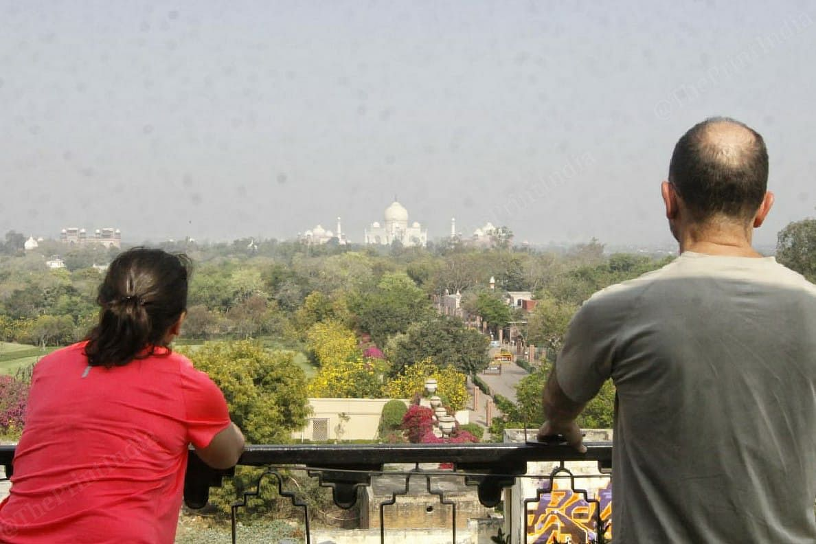 Francisco and his wife Belen from Spain arrived in India on 4th of March and their stuck in Agra. On the Janata curfew day they look at Taj Mahal from their hotel | Photo: Praveen Jain | ThePrint