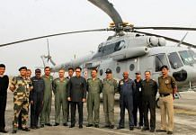 Union minister Kiren Rijiju with officers in front of a BSF Air Wing helicopter (representational image) | Photo: Commons