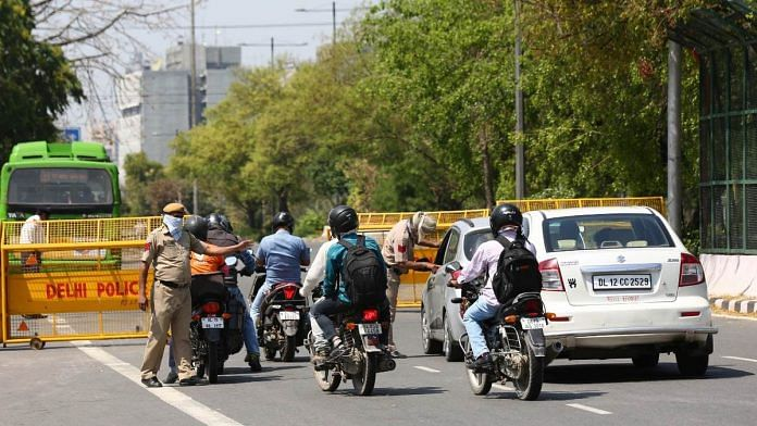 Only employees engaged in 'essential services' are allowed to be on the roads during the 21-day coronavirus lockdown in India | Photo: Suraj Singh Bisht | ThePrint