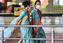 Airline employees seen wearing masks as a precautionary measure against coronavirus at Mumbai international airport