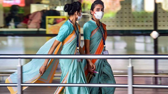 Airline employees seen wearing masks as a precautionary measure against coronavirus at Mumbai international airport