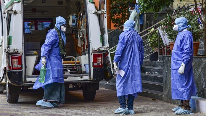 Medical workers attend to a suspected COVID-19 patient in Hyderabad | PTI