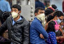 Passengers at the Prayagraj Railway Station wear masks as a preventive measure for coronavirus, on 16 March 2020 | PTI