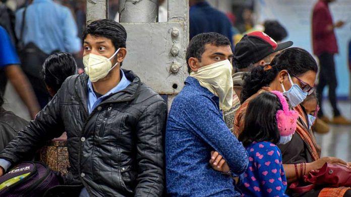 Passengers at the Prayagraj Railway Station wear masks as a preventive measure for coronavirus, on 16 March 2020 | PTI