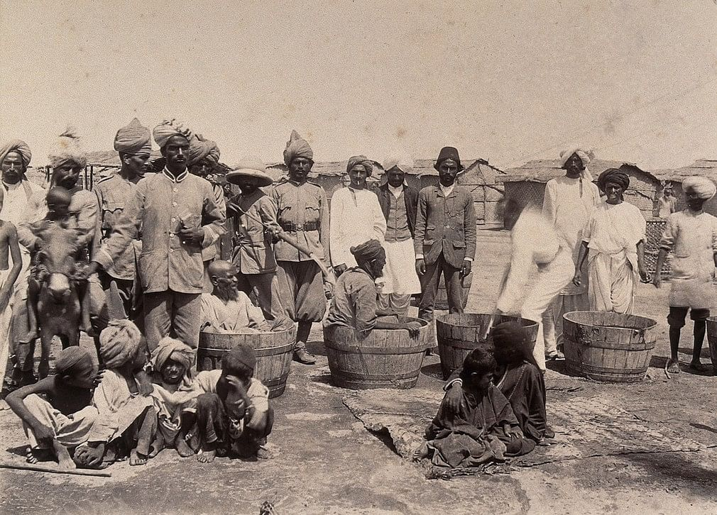 Authorities disinfecting plague patients in wooden tubs, Karachi, 1897. | Wellcome Library archive collection