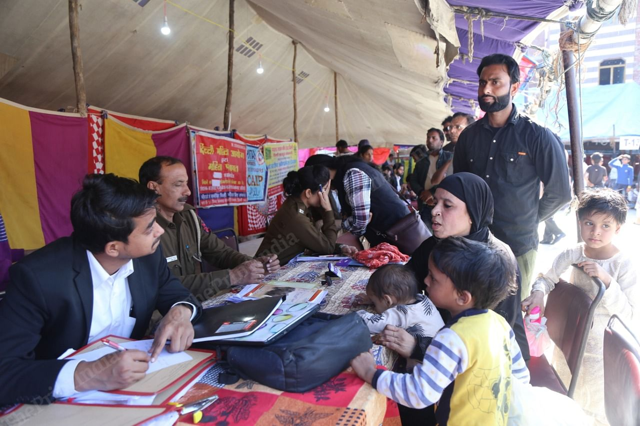 The legal and police help desks at the Mustafabad relief camp helping people file complaints.