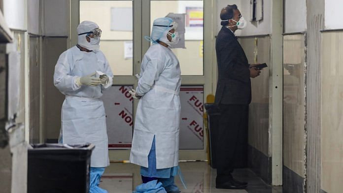Medics wearing protective masks inside the novel coronavirus isolation ward of Government Medical College Hospital in Jammu | PTI