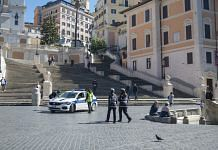 A police car sits at the bottom of the Spanish Steps in Rome