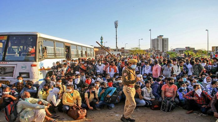 A file photo of migrant labourers gathered at a bus stand in Jaipur | PTI