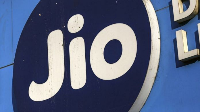 The logo of Reliance Jio, the mobile network of Reliance Industries Ltd., is displayed at a store in Mumbai, India. | Photographer: Dhiraj Singh | Bloomberg