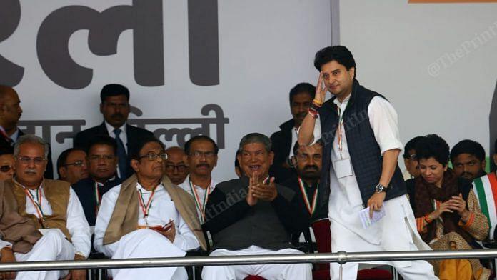 Jyotiraditya Scindia salutes the crowd before speaking at a Congress rally | Suraj Singh Bisht | ThePrint File Photo