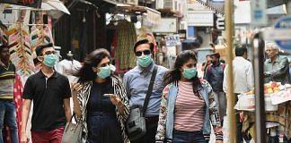 People wear masks as a precaution against coronavirus   PTI File Photo