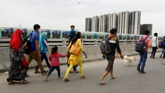 People walk back to their villages along the Delhi-Meerut Expressway. The lockdown has shut all means of interstate public transport | Praveen Jain | ThePrint