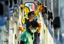Railway workers disinfect coaches of the Delhi-Jammu Rajdhani Express train as a measure against the coronavirus pandemic, at New Delhi Railway Station, on 15 March 2020   Arun Sharma   PTI
