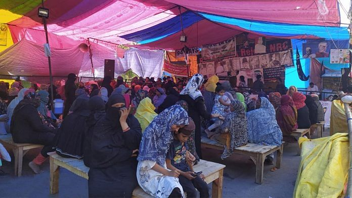 Women sit on wooden benches at the Shaheen Bagh protest site | Photo by special arrangement