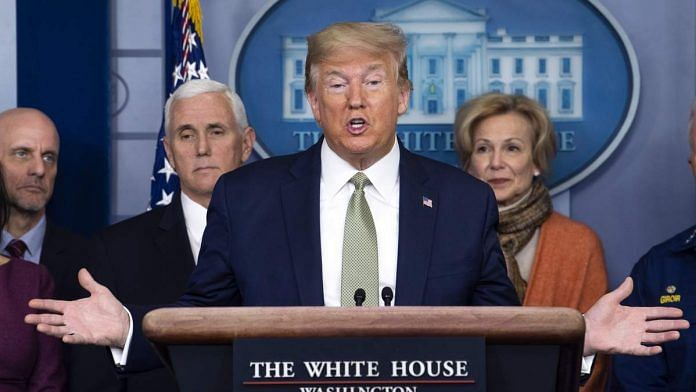 US President Donald Trump, with Anthony Fauci and Deborah Birx, speaks during a Coronavirus Task Force news conference in the briefing room of the White House in Washington, D.C. | Photographer Kevin Dietsch/UPI/Bloomberg