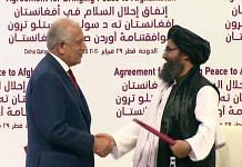 United States Special Representative for Afghanistan Zalmay Khalilzad and top Taliban leader Mullah Abdul Ghani Baradar shake hands after signing the peace agreement, in Doha on 29 February