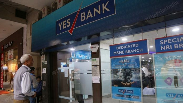A man outside Yes Bank branch in New Delhi | Manisha Mondal | ThePrint