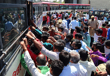File photo | A crowd of migrant workers gather around the UPSRTC buses near the Delhi-Ghaziabad border | Photo: Suraj Singh Bisht | ThePrint