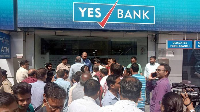 Account holders stand in a queue to withdraw money from Yes Bank at Bandra, Mumbai, Friday   Photo: ANI