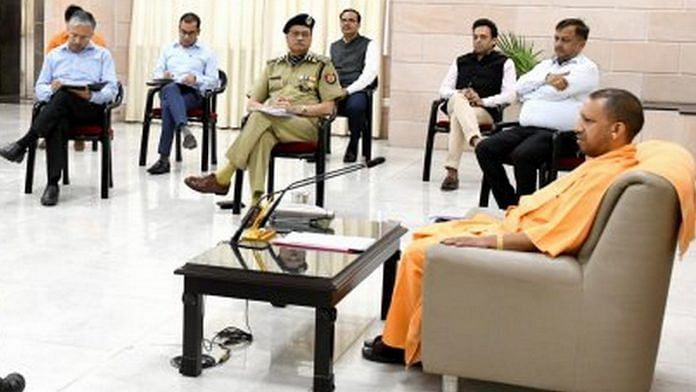 Uttar Pradesh Chief Minister Yogi Adityanath with police and administration officials at his residence Tuesday (representational image)   Photo: UP Information & Public Relations Department