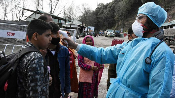 A medical worker checks the body temperature of a man while screening people for Covid-19 in Jammu and Kashmir | Representational image | Photo: ANI