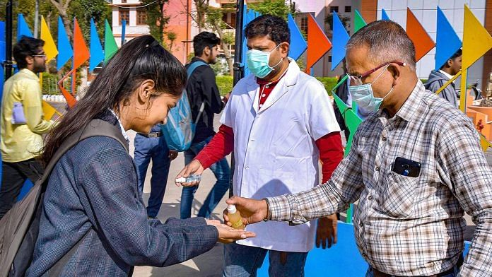 Students sanitise their hands outside a school in Bikaner | PTI