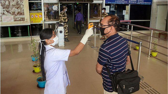 Thermal screening of passengers at MBB airport in Agartala | PTI