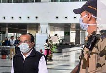 Security personnel and passengers wear masks to mitigate the spread of coronavirus at Raja Bhoj Airport in Bhopal, Friday I