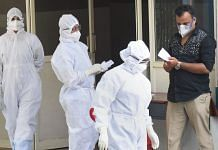 Medical staff members wear masks and protective suits outside an isolation ward in Kochi | PTI Photo