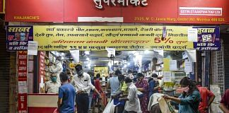 Locals buy vegetables and essential goods at a market after the announcement of lockdown in wake of coronavirus pandemic, at Worli in Mumbai. | PTI